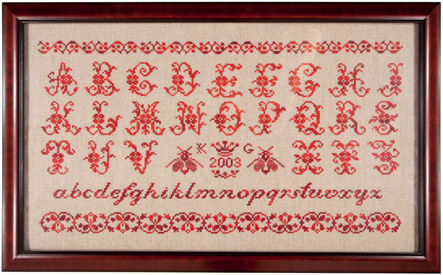 Les Abeilles red on white French stitched sampler